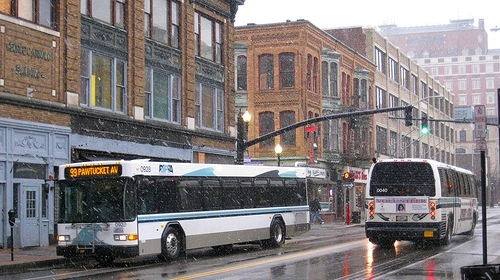 RIPTA buses passing each other on Washington Street in Downcity Providence