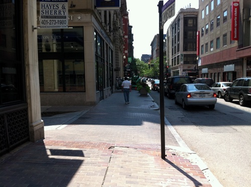 Sidewalk on Westminster Street continues right across Orange Street.